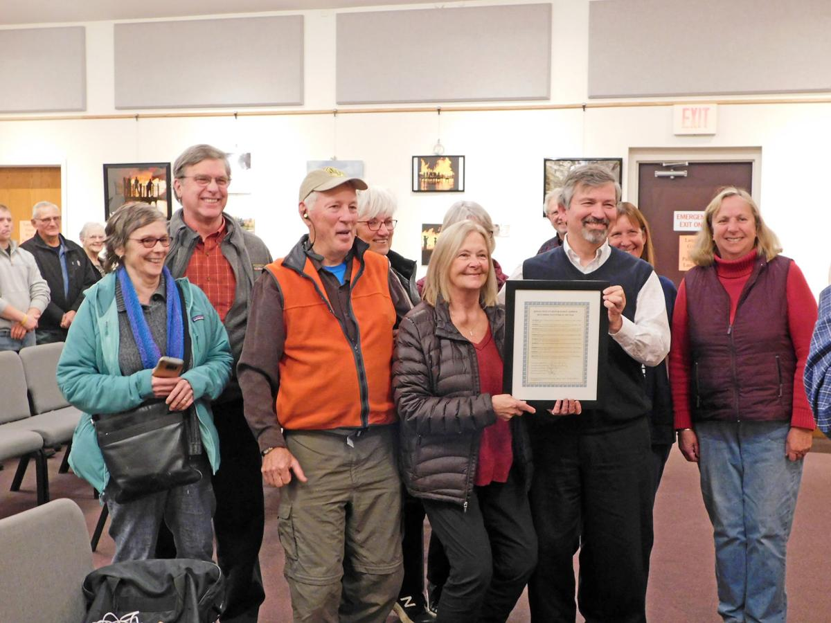 Marcia Herrick and members of the trail committee pose for a photo with her and her award. Front row (left to right): Deborah Trumbull, Roger Hopkins, Marcia Herrick, Edward LaVigne and Reenie Baker Sandsted. Back row: Gary Mallow, Ruth Hopkins, Maureen Cowan and Susan Ruoff.