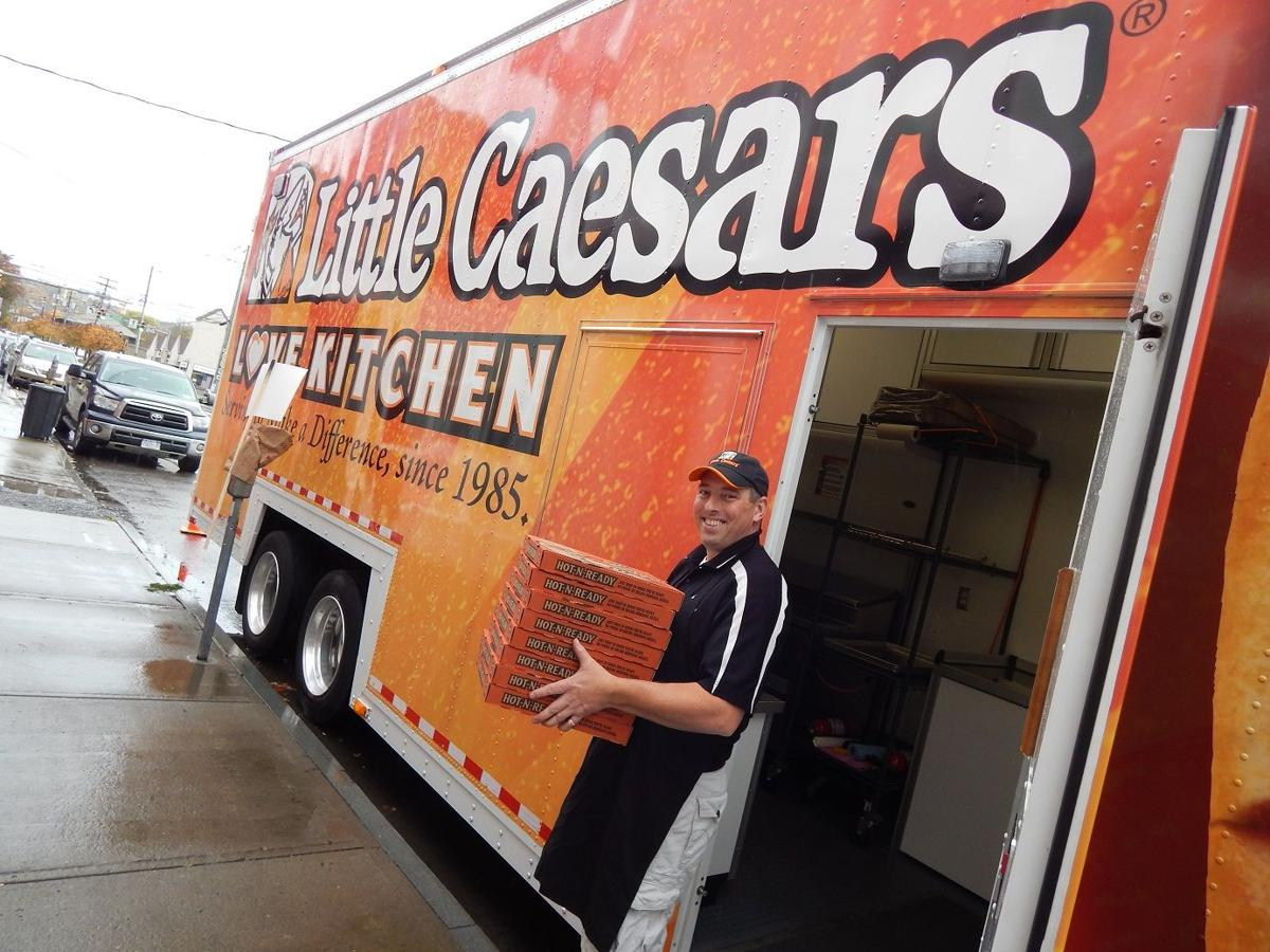 Local little caesars franchisee bill beveridge outside the love kitchen pizza truck on west state street oct 28 2015
