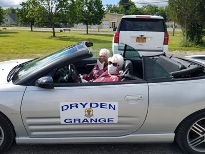 Anne Grant in the driver's seat in her convertible, leading the 2020 Dryden Dairy Day parade.