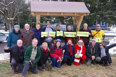 Members of the Rail Trail Task Force and Friends of Dryden Rail Trail pose in front of a trail kiosk back in December 2018.