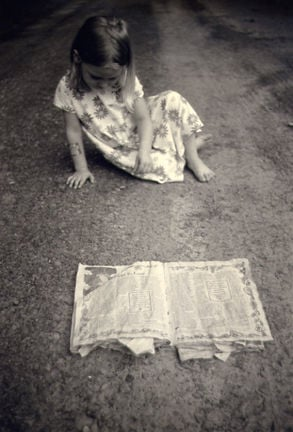 """""""Sadie and Newspaper"""", 2008.  From the series Notes from Under the Milky Way.  7""""x5"""", silver gelatin print toned with selenium and Lipton tea"""""""