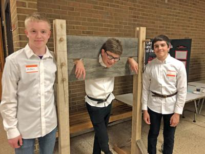 Aidan Swayze, Logan Jewell pilloried, and Jayden Grube at Shakespearience night. See story on page 3.