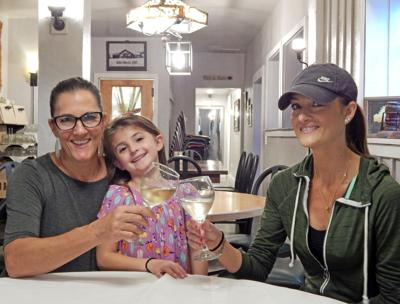 Terry Ferrara, owner of Stella's Barn, with daughter Lauren Ferrara Carpenter and granddaughter Lyla Carpenter.