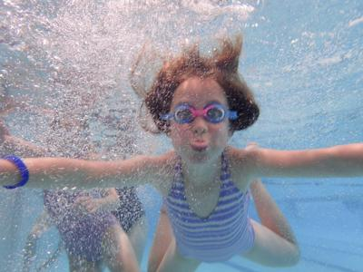 Audrey Murphy, eight years old, enjoys the waters at the YMCA.