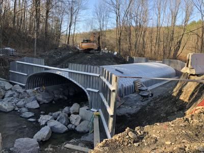The repair of Hulbert Hollow bridge in Spencer is moving along quickly, and contractors hope to finish by Nov. 30.