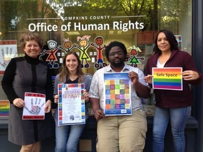 The four-person staff at the Tompkins County Office of Human Rights. From left to right: Karen Baer, Rebecca Sims, Xavier Rusk, and Carmen Arroyo.