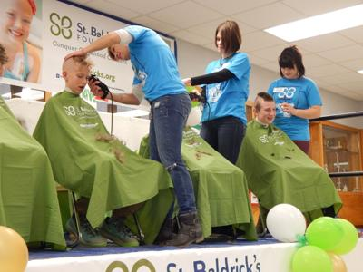 Members of Brave for the Shave get their heads shaved