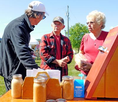 Visitors to the Candor Farmers' Market June 9 sample honey from David Hopkins of Sky Barn Honey back in 2017.