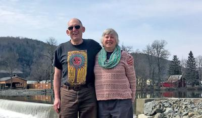 Lou and Sue Heavenrich in one of their favorite spots in Candor, next to the dam near the Village entrance. The couple were just named Candor People of the Year.
