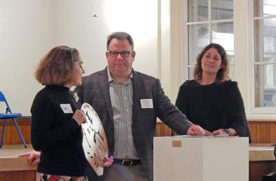 Deb Austin, director of Trumansburg Community Nursery School, accepts the award for Organization of the Year from Steven Daly, owner of Ithaca Vintage, as Chamber President Elaine Springer looks on at the Trumansburg Area Chamber of Commerce 2019 gala Nov. 22.