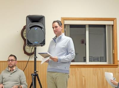 Adam Walters, attorney for Ithaca Neighborhood Housing Services, talks to the Trumansburg Village Planning Board at a meeting of the board Oct. 24.
