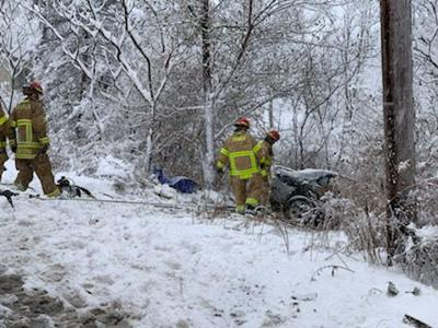 Car in an embankment on Slaterville Rd.