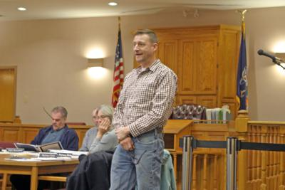 Scott Gibson speaks in front of the Town of Groton Planning Board and the public about the proposed modifications to the Route 34B Self Storage, LLC construction plan on April 4.