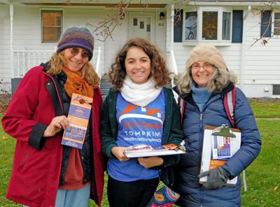 Mary Alyce Kobler (left), Leigh Miller (middle) and Lisa Marshall (right) pose for a photo will canvasing the Lansing neighborhoods.