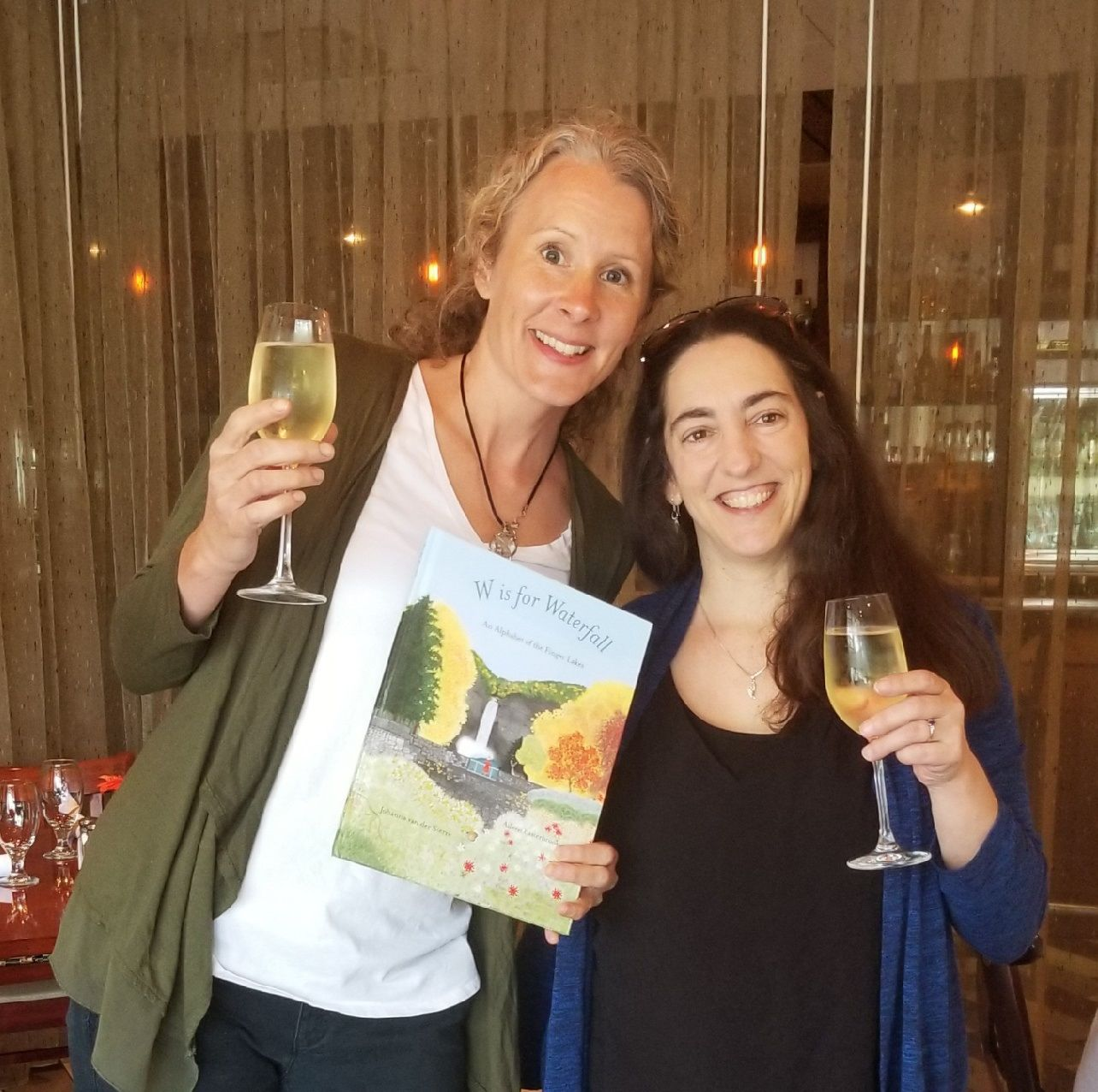 Johanna van der Sterre and Aileen Easterbrook celebrate publication of their local-interest picture book with a toast to all things Finger Lakes.