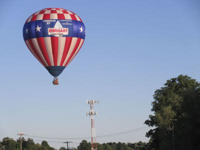An example of a hot air balloon mid-flight, which offers an far-ranging view of everything from Cayuga Lake to Buttermilk Falls.