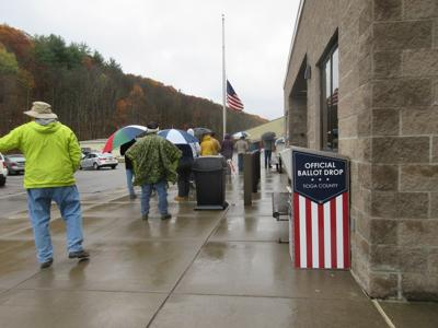 Despite the drizzle, 677 people showed up on the first day of early voting in Tioga County.