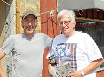 Stephen Haner (left), new manager of the Firehouse Coffee, and one of the regulars, Dick Zavatto.