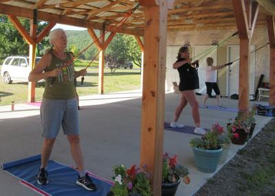 Community members join Ron and Barb Fay for exercise under shelter of the pavilion on Tuesday evenings.