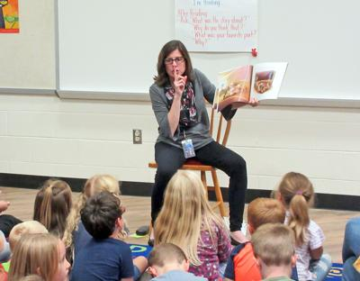 Candor Elementary School library teacher Wendy Bruttomesso leads an interactive story time for kindergarteners at the recent Great Beginnings Family Reading Program.