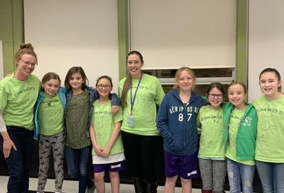 Green Team co-advisors Kate McKee (furthest left) and JoAnne Anderson (middle) pose with some of the elementary school students in the sustainability club.
