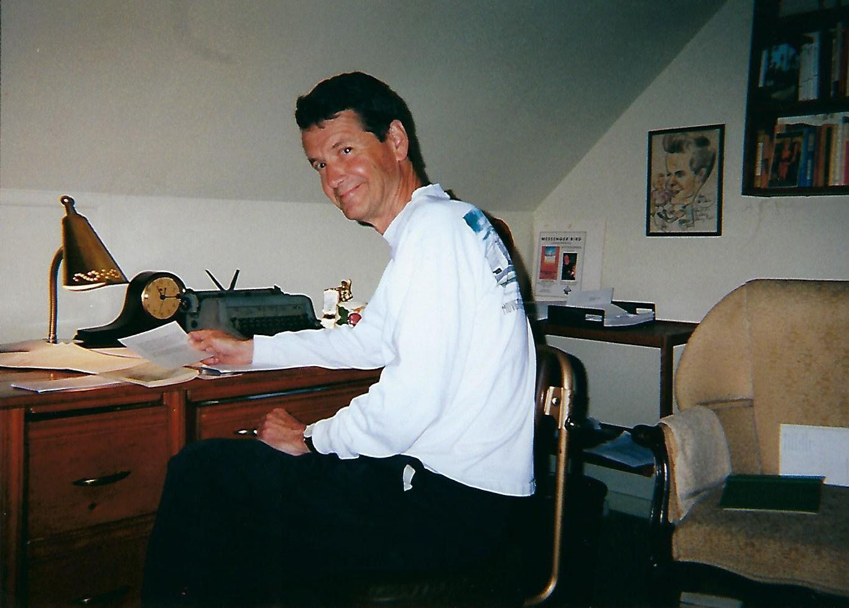1018_Cov_Dan at his desk.jpg