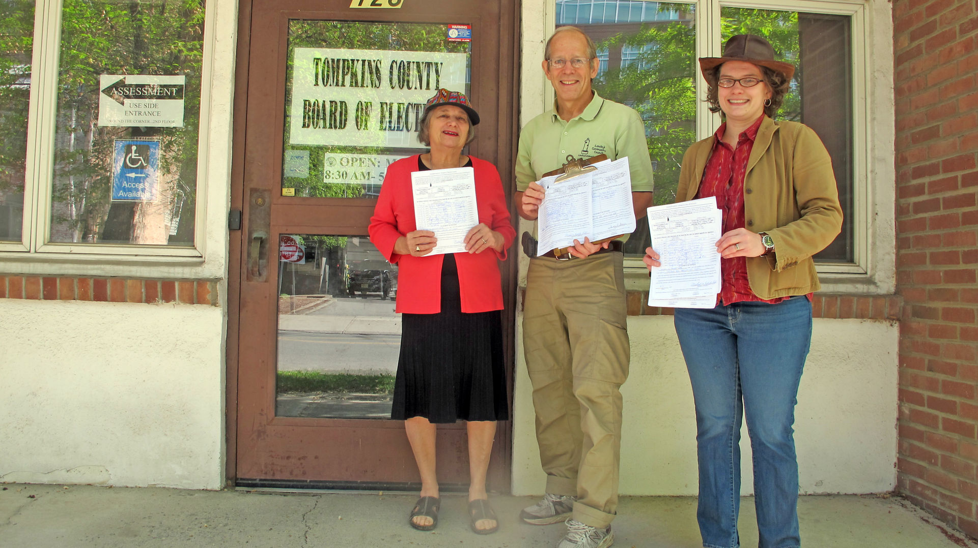 Andra Benson, Michael Koplinka-Loehr, and Bronwyn Losey at the Tompkins County Board of Elections.