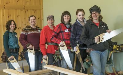 Maria Klemperer Johnson, at right, with a basic carpentry skills class. They start with hand tools and progress to power tools