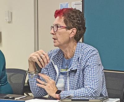Lansing Board of Education Member Linda Pasto speaking during a meeting on Sept. 25. The board discussed possible revisions to its background check policies for volunteers at the district.