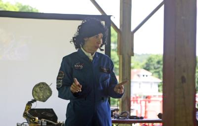 Sheril Faye performs as Sally Ride at the Groton Memorial Park Pavilion on July 24.