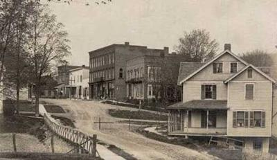 Newfield's business district at the end of the 19th century was busy with shops, the hotel, the bank, and other enterprises.