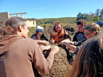 Candor High School students build a cob wood-fired pizza oven in Newfield Oct. 5 under the instruction of Matteo Lundgren of Cob Therapy. The build is part of the Winners Circle Project.