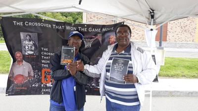 Trazz Sawyer with Joe Ponder. Ponder is co-author of the book The Crossover That Won the Game and producer of the movie by the same name. Cinemapolis will host a screening of the film on Friday, September 20 at 6:30 PM. (Photo courtesy of Facebook)