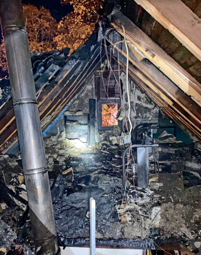 The damage done by a chimney fire in the attic of a residence in Trumansburg Tuesday morning. No one was injured in the blaze.