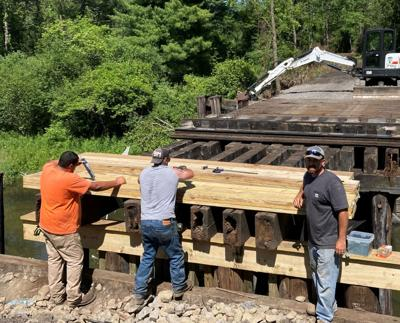 Work by the Town of Dryden Highway Department is progressing on renovation for trail use of the two timber-trestle railroad bridges near Game Farm Road.