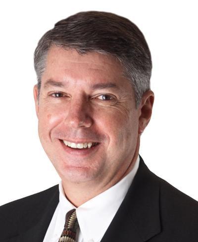 Austin Bank president/CEO John P. Williams announces retirement