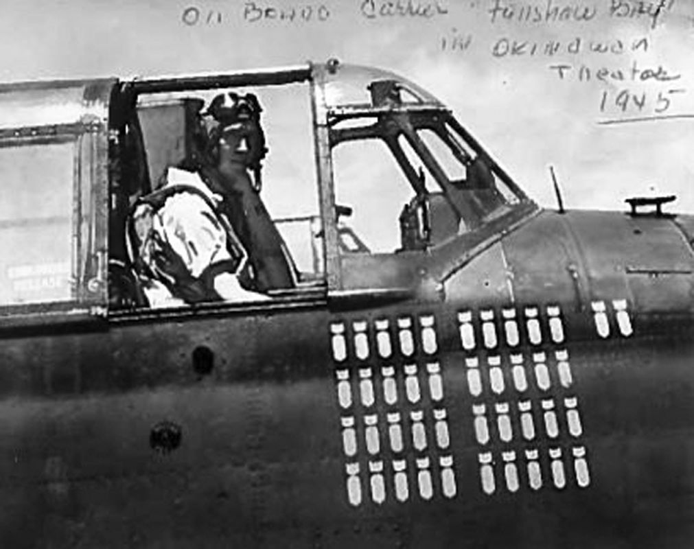 Local veteran Jimmy Hines sits in a bomber plane in 1945.