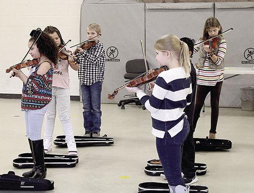 Third graders give violin concert