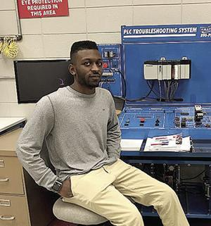 <p>Johnthan Evans sits in front of one of the systems he works with as an electrical technology student at EPCOT.  This North Jackson High School senior was selected as the EPCOT Student of the Month for October. He is planning a career in the military following his high school graduation.</p>