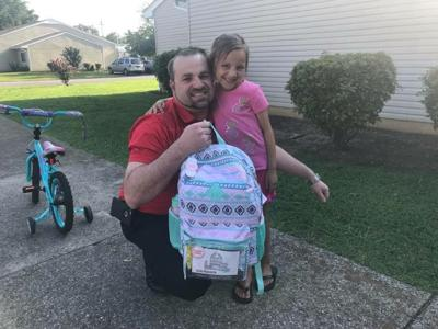 Business buys school supplies for 17 students