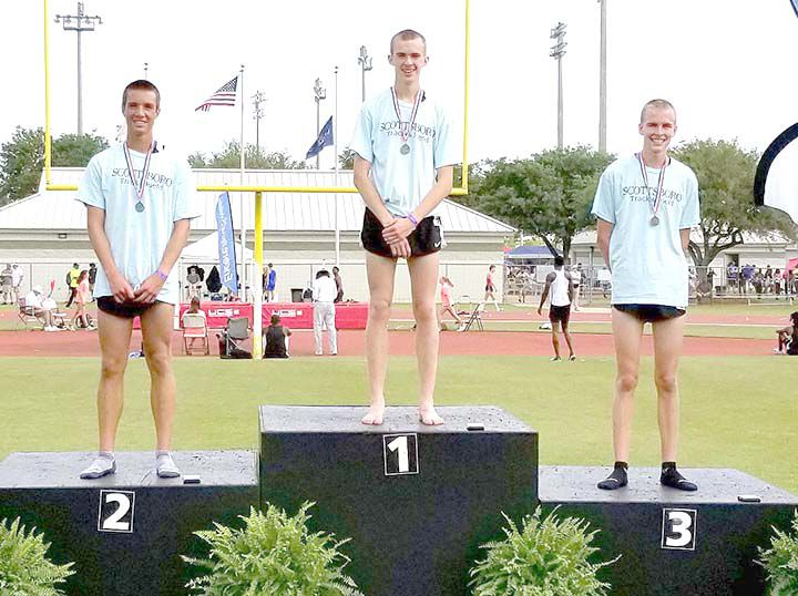 Three Scottsboro runners on the medal podium