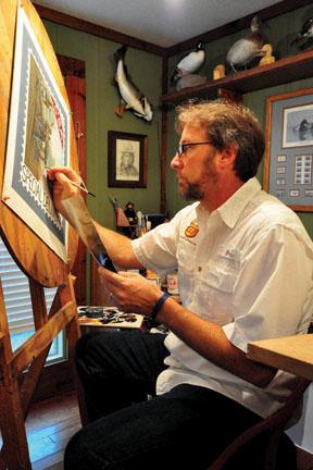 John Warr painting in his studio