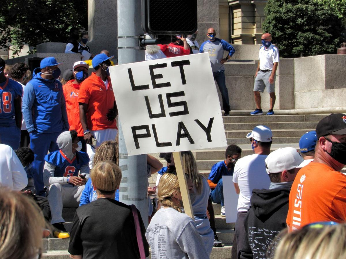 Let Us Play sign