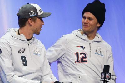 Eagles backup quarterback Nick Foles and New England Patriots quarterback Tom Brady meet during a interview before Super Bowl LII last year.