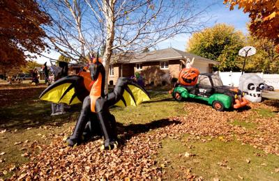 Yard full of Halloween decorations await trick-or-treaters