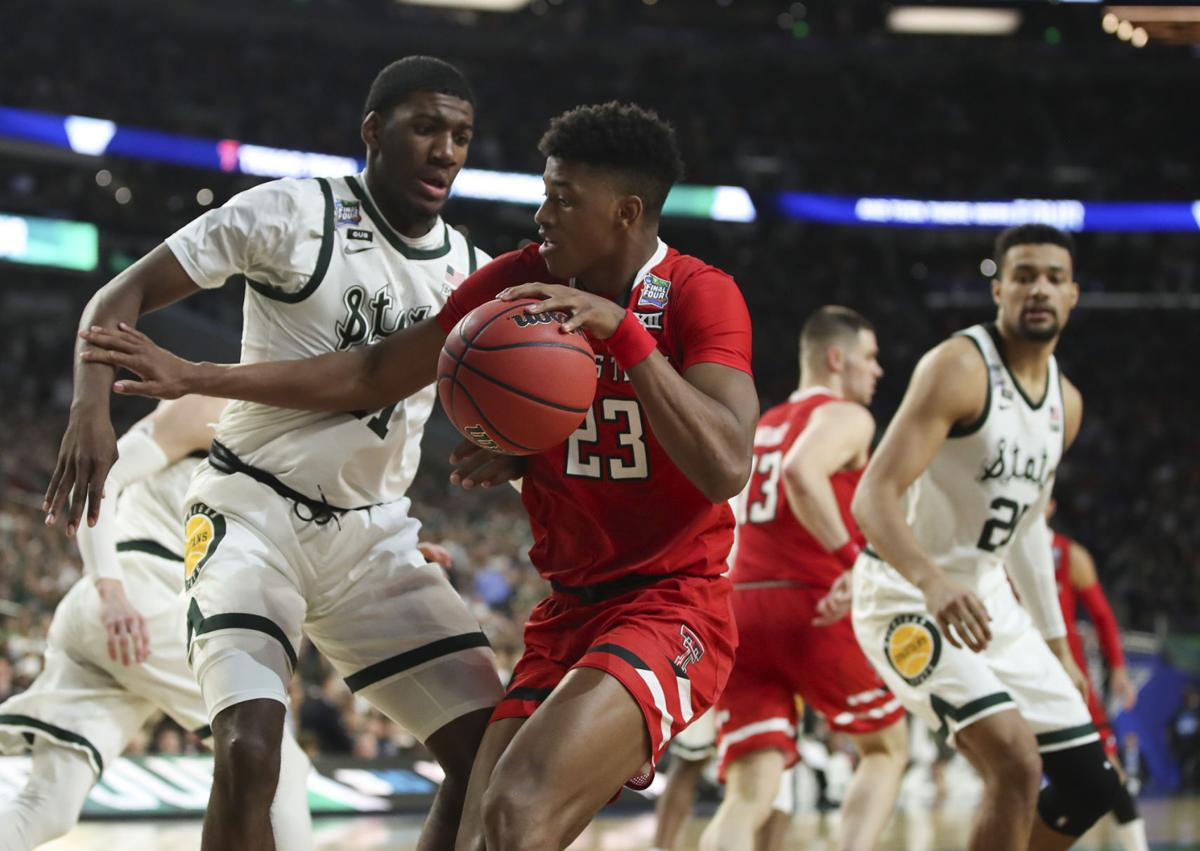 Texas Tech's Jarrett Culver (23) tries to move against Michigan State's Aaron Henry (11) during the second half in a semifinal of the NCAA Tournament Final Four on Saturday, April 6, 2019, at U.S. Bank Stadium in Minneapolis.