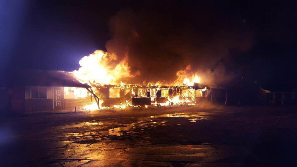 Part of former U.S. Grant Motel in flames