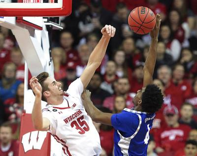 E Illinois Wisconsin Basketball