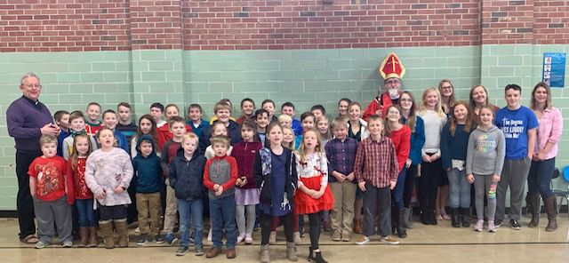 Area students get a visit from ol' St Nicholas during Haiti Connection project