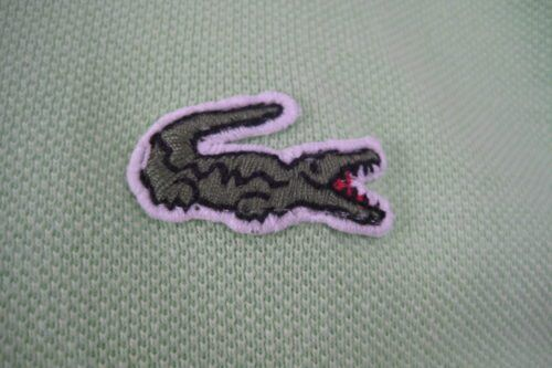 Lacoste Is Temporarily Changing Its Logo—and It's For A Great Cause!